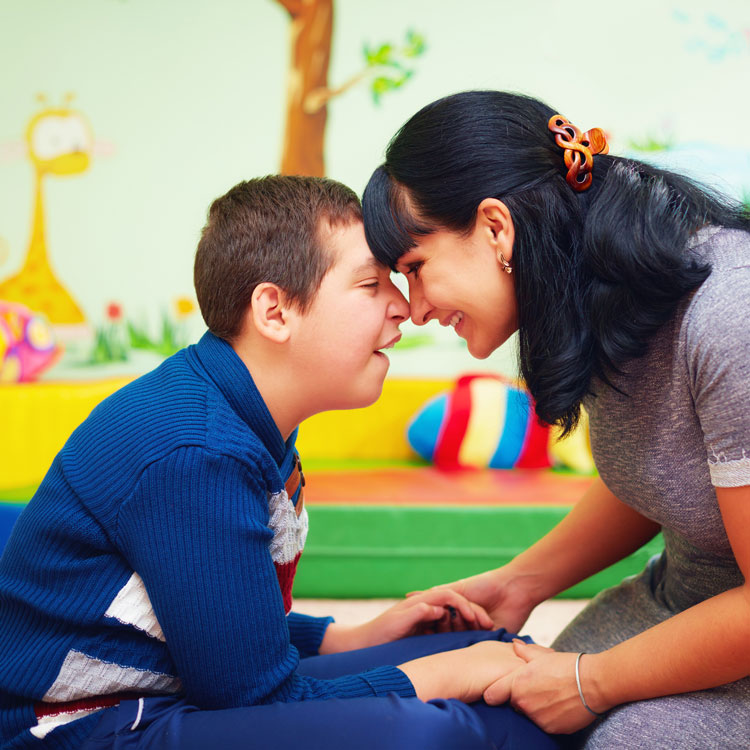 mother and her son with disability in rehabilitation centre