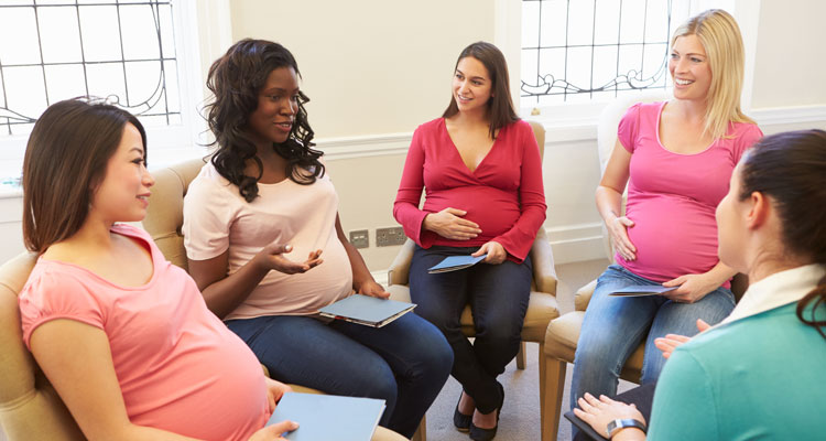 Pregnant Women Meeting At Pre Natal Class, sitting in a circle